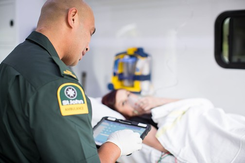 Ambulance officer treating patient